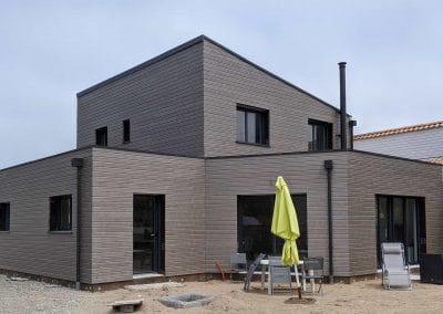 Maison à ossature bois avec bardage gris